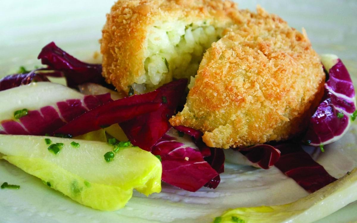 Colliers Cheese Breadcrumbed White Onion and Collier's Cheddar Risotto Cake with a Radicchio and Chicory Salad and Honey