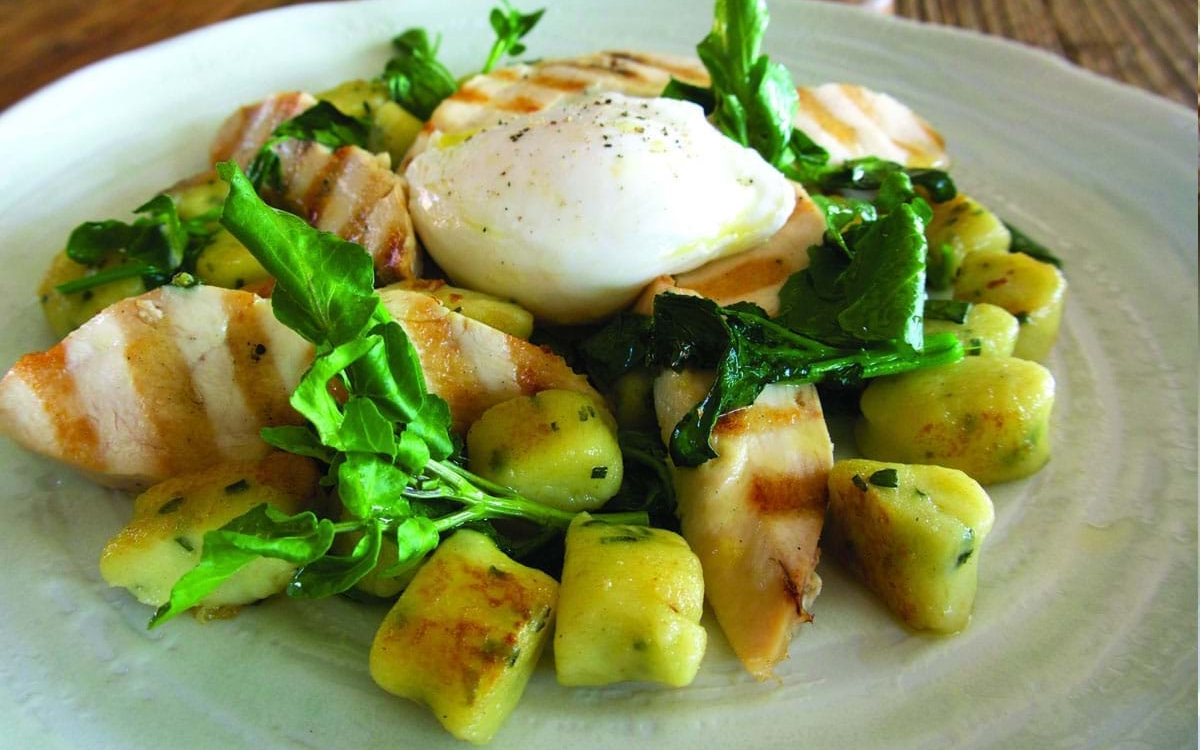 Colliers Cheese Collier's Cheddar Gnocchi, Grilled Chicken, Watercress, poached egg & celery salt